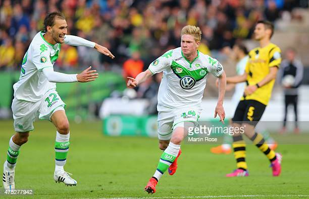 Kevin De Bruyne of VfL Wolfsburg celebrates after scoring his teams second goal during the DFB Cup Final match between Borussia Dortmund and VfL...