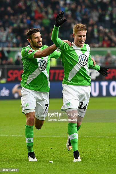 Kevin De Bruyne of VfL Wolfsburg celebrates as he scores the opening goal during the Bundesliga match between VfL Wolfsburg and SC Freiburg at...