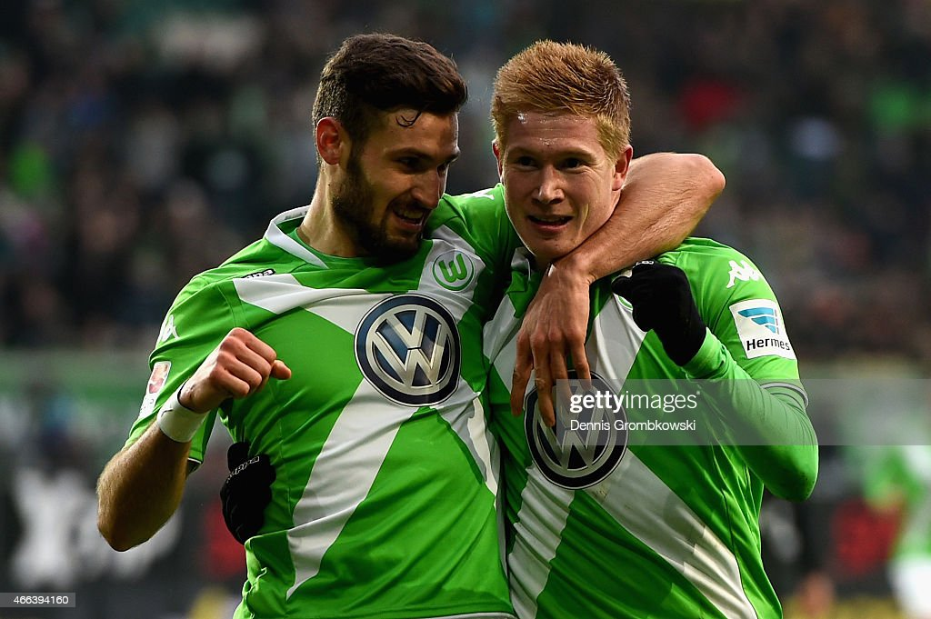 <a gi-track='captionPersonalityLinkClicked' href=/galleries/search?phrase=Kevin+De+Bruyne&family=editorial&specificpeople=6165471 ng-click='$event.stopPropagation()'>Kevin De Bruyne</a> of VfL Wolfsburg celebrates as he scores the opening goal during the Bundesliga match between VfL Wolfsburg and SC Freiburg at Volkswagen Arena on March 15, 2015 in Wolfsburg, Germany.