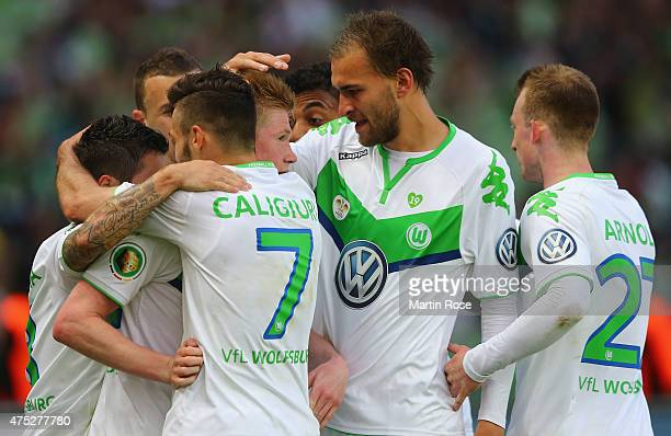 Kevin De Bruyne of VfL Wolfsburg celebrates with team mates after scoring his teams second goal during the DFB Cup Final match between Borussia...