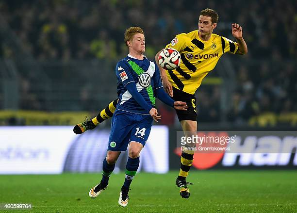 Kevin De Bruyne of VfL Wolfsburg is challenged by Sven Bender of Borussia Dortmund during the Bundesliga match between Borussia Dortmund and VfL...
