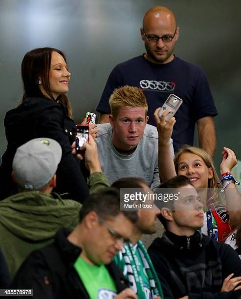 Kevin de Bruyne of Wolfburg is seen with fans during the Bundesliga match between VfL Wolfsburg and FC Schalke 04 at Volkswagen Arena on August 28...