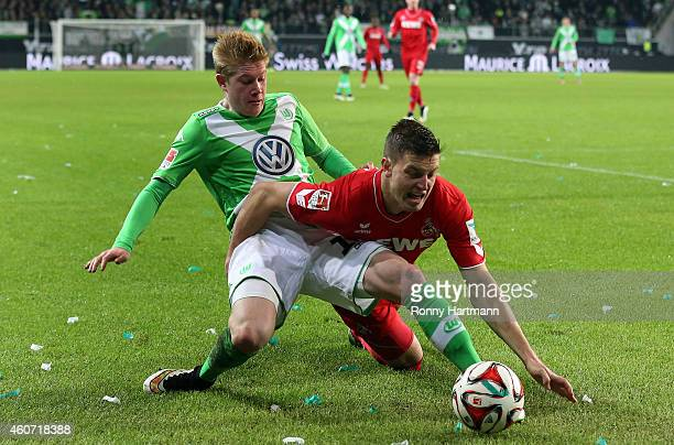 Kevin De Bruyne of Wolfsburg and Kevin Wimmer of Koeln vie during the Bundesliga match between VfL Wolfsburg and 1 FC Koeln at Volkswagen Arena on...