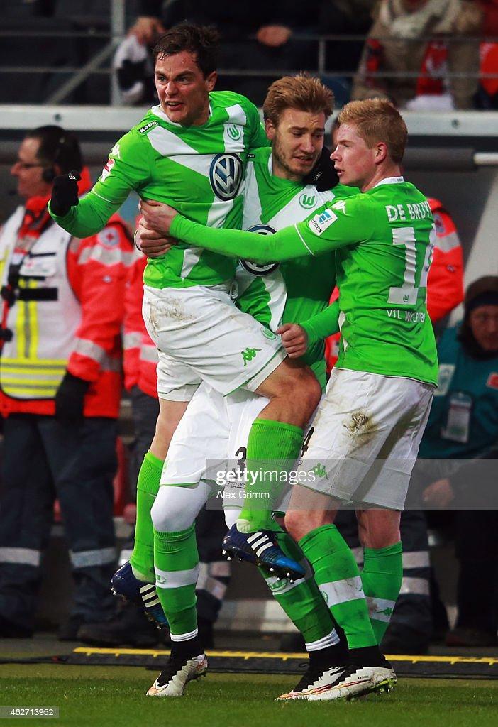 Kevin de Bruyne of Wolfsburg celebrates his team's first goal with team mates Nicklas Bendtner and Marcel Schaefer during the Bundesliga match...