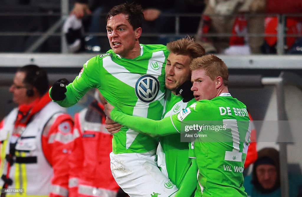 Kevin de Bruyne of Wolfsburg celebrates his team's first goal with team mates <a gi-track='captionPersonalityLinkClicked' href=/galleries/search?phrase=Nicklas+Bendtner&family=editorial&specificpeople=2142069 ng-click='$event.stopPropagation()'>Nicklas Bendtner</a> and <a gi-track='captionPersonalityLinkClicked' href=/galleries/search?phrase=Marcel+Schaefer&family=editorial&specificpeople=656515 ng-click='$event.stopPropagation()'>Marcel Schaefer</a> (R-L) during the Bundesliga match between Eintracht Frankfurt and VfL Wolfsburg at Commerzbank-Arena on February 3, 2015 in Frankfurt am Main, Germany.