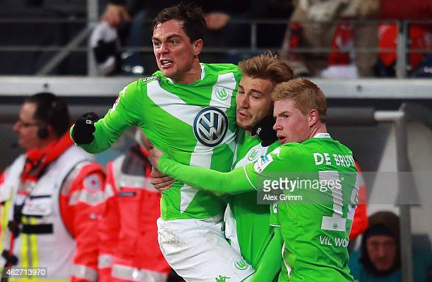 Kevin de Bruyne of Wolfsburg celebrates his team's first goal with team mates Nicklas Bendtner and Marcel Schaefer during the Bundesliga match...