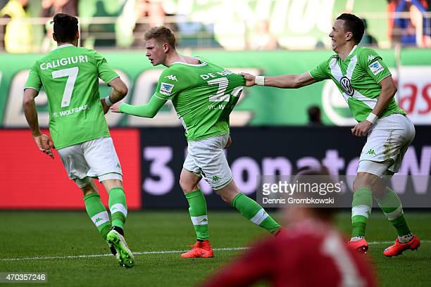 Kevin De Bruyne of Wolfsburg celebrates scoring the first team goal with his team mates during the Bundesliga match between VfL Wolfsburg and FC...