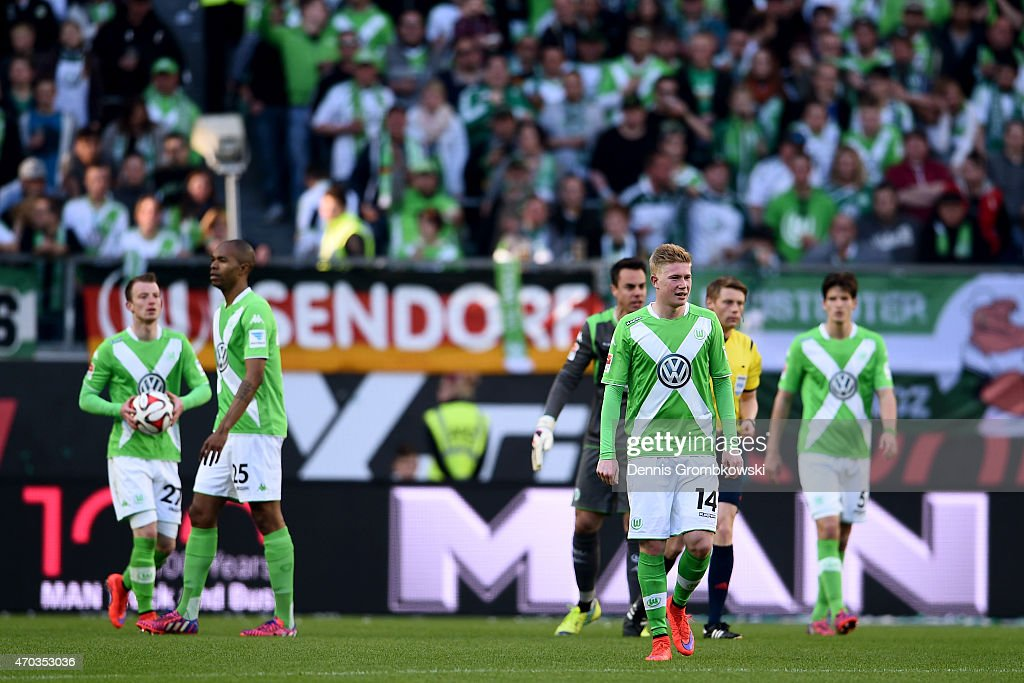 Kevin De Bruyne (C-R) of Wolfsburg reacts with his team mates after receiving the first goal during the Bundesliga match between VfL Wolfsburg and FC Schalke 04 at Volkswagen Arena on April 19, 2015 in Wolfsburg, Germany.