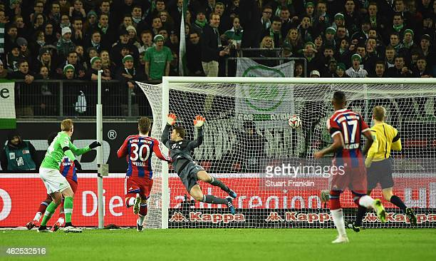 Kevin de Bruyne of Wolfsburg scores the fourth goal during the Bundesliga match between VfL Wolfsburg and FC Bayern Muenchen at Volkswagen Arena on...