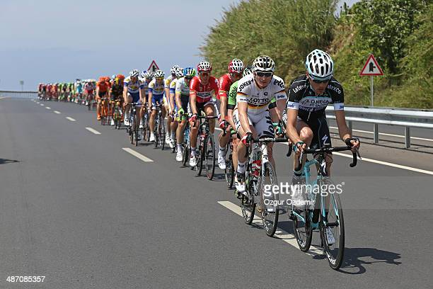 Kevin De Weert of Germany and team OmegaPharma Quck Step ahead Andre Greipel of Germany and team Lotto Belisol during the first stage of the...