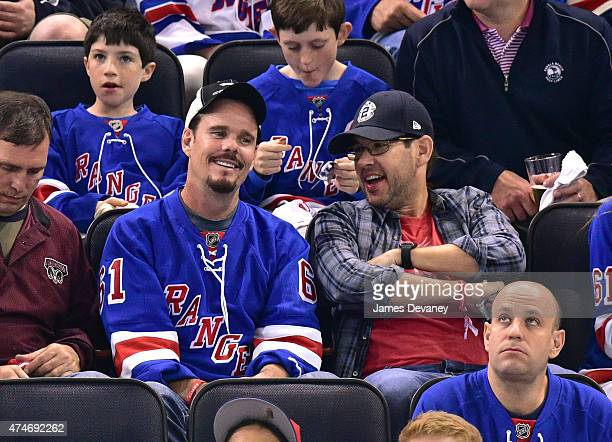 Kevin Dillon and Doug Ellin attend the Tampa Bay Lightning vs New York Rangers playoff game at Madison Square Garden on May 24 2015 in New York City