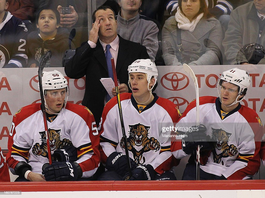 <a gi-track='captionPersonalityLinkClicked' href=/galleries/search?phrase=Kevin+Dineen&family=editorial&specificpeople=654130 ng-click='$event.stopPropagation()'>Kevin Dineen</a>, head coach of the Florida Panthers, rubs his head as Drew Shore #50, Shawn Matthias #18 and <a gi-track='captionPersonalityLinkClicked' href=/galleries/search?phrase=Jonathan+Huberdeau&family=editorial&specificpeople=7144196 ng-click='$event.stopPropagation()'>Jonathan Huberdeau</a> #11 look on from the bench during a game against the Winnipeg Jets on February 5, 2013 at the MTS Centre in Winnipeg, Manitoba, Canada.