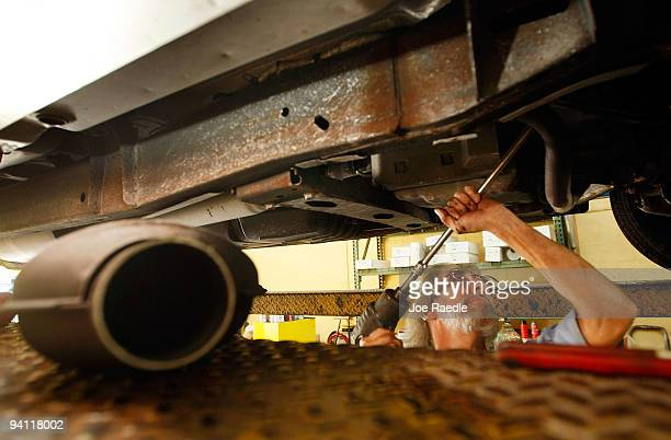 Kevin Doyle from Mad Hatter Muffler shop works on replacing a catalytic converter on a truck on December 7 2009 in Davie Florida The Environmental...