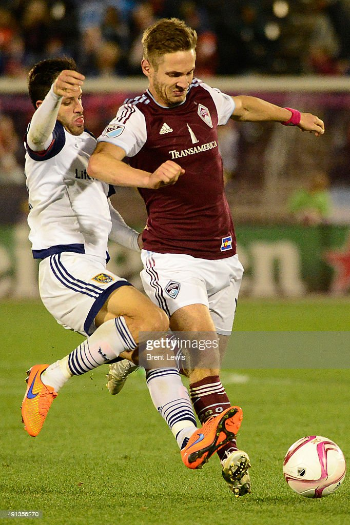 <a gi-track='captionPersonalityLinkClicked' href=/galleries/search?phrase=Kevin+Doyle+-+Soccer+Player&family=editorial&specificpeople=661496 ng-click='$event.stopPropagation()'>Kevin Doyle</a> (9) of Colorado Rapids tries to get around the defense of Juan Manuel Martinez (22) of Real Salt Lakeduring the second half October 4, 2015 at Dick's Sporting Goods Park. Colorado Rapids lost 2-1 against Real Salt Lake, but took back the Rocky Mountain Cup.