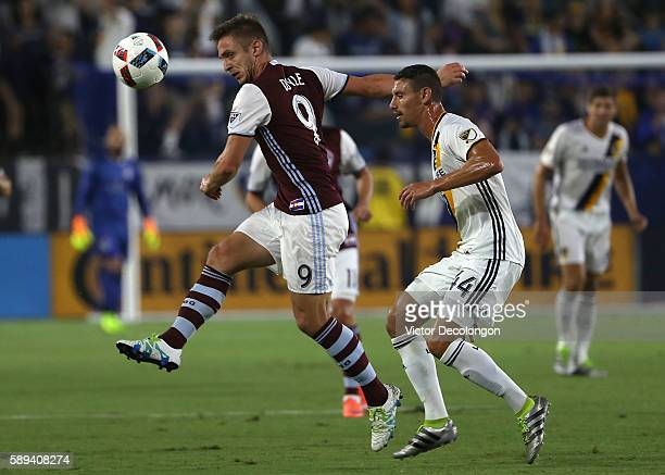 Kevin Doyle of Colorado Rapids volleys a pass as Daniel Steres of Los Angeles Galaxy defends during the first half of their MLS match at StubHub...