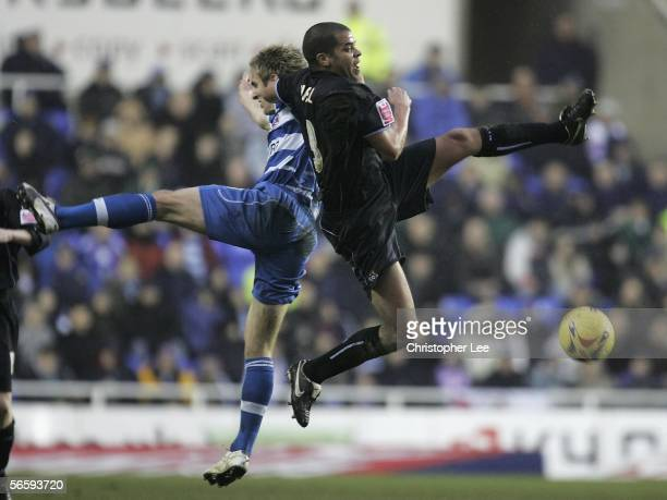 Kevin Doyle of Reading and Marcus Hall of Coventry City jump to win the ball during the CocaCola Championship match between Reading and Coventry City...