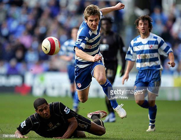 Kevin Doyle of Reading avoids the challenge by Glen Johnson of Portsmouth during the Barclays Premiership match between Reading and Portsmouth at the...