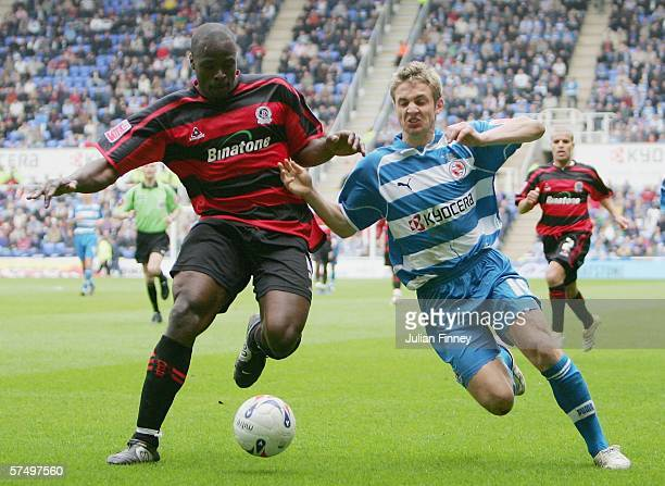 Kevin Doyle of Reading battles with Daniel Shittu of QPR during the CocaCola Championship match between Reading and Queens Park Rangers at the...