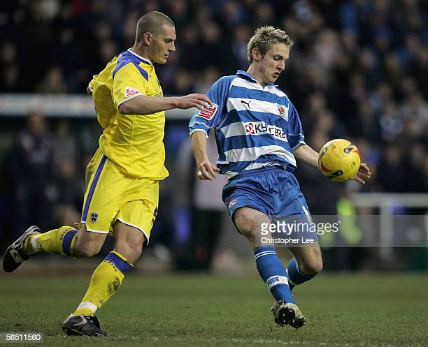 Kevin Doyle of Reading battles with Darren Purse of Cardiff City during the CocaCola Championship match between Reading and Cardiff City at the...
