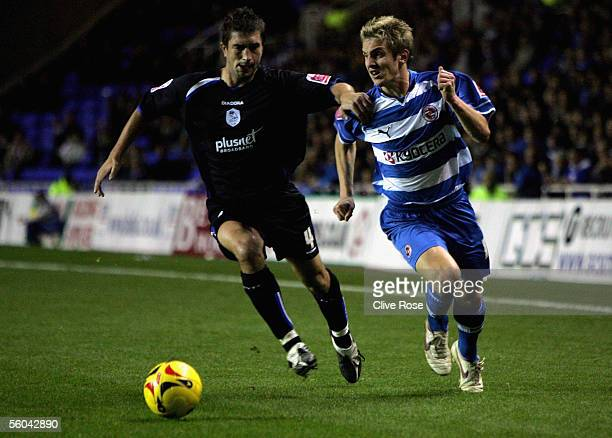 Kevin Doyle of Reading battles with Graeme Lee of Sheffield Wednesday during the CocaCola Championship match between Reading and Sheffield Wednesday...