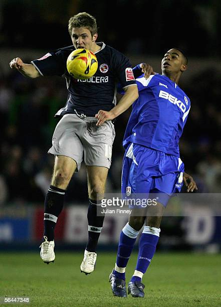 Kevin Doyle of Reading battles with Marvin Elliott of Millwall during the CocaCola Championship match between Millwall and Reading at The New Den on...