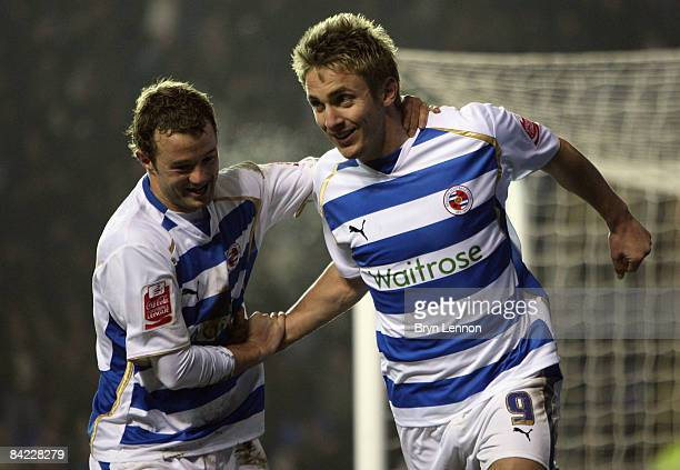 Kevin Doyle of Reading celebrates with team mate Noel Hunt after scoring during the Coca Cola Championship match between Reading and Watford at the...