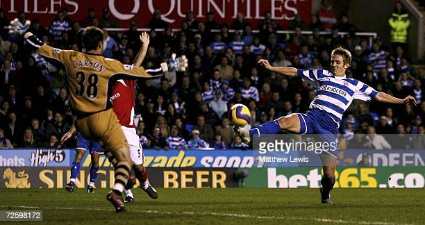 Kevin Doyle of Reading chips Scott Carson of Charlton to score a goal during the Barclays Premiership match between Reading and Charlton Athletic at...
