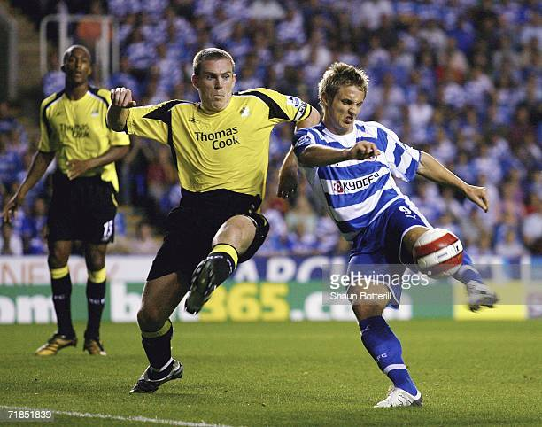 Kevin Doyle of Reading fires in a shot as Richard Dunne of Manchester City tries to challenge during the Barclays Premiership match between Reading...