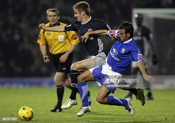 Kevin Doyle of Reading is tackled by Sito Castro of Ipswich during the Coca Cola Championship match between Ipswich Town and Reading at Portman Road...