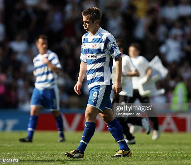 Kevin Doyle of Reading looks dejected after his team are relegated from the Premiership after the Barclays Premier League match betweeen Derby County...