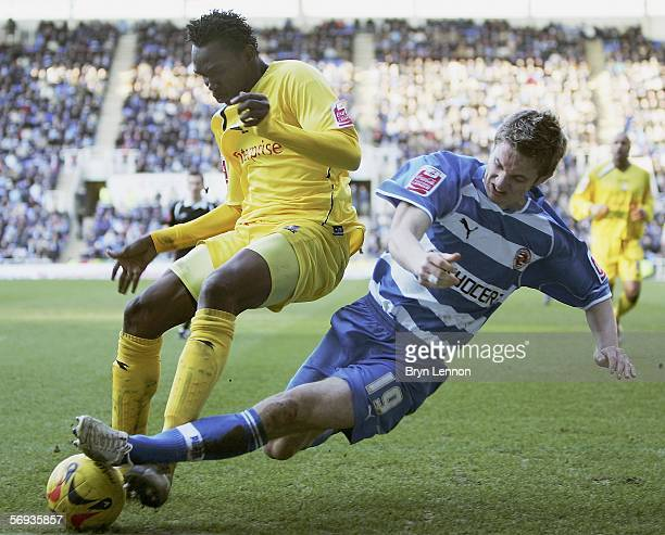 Kevin Doyle of Reading tackles Claude Davis of Preston North End during the CocaCola Championship match between Reading and Preston North End at the...