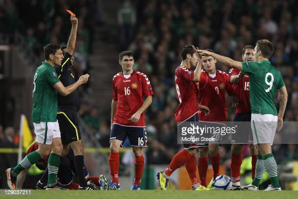 Kevin Doyle of Republic of Ireland is sent off by referee Eduardo Gonzalez of Spain during the EURO 2012 Group B qualifying match between the...