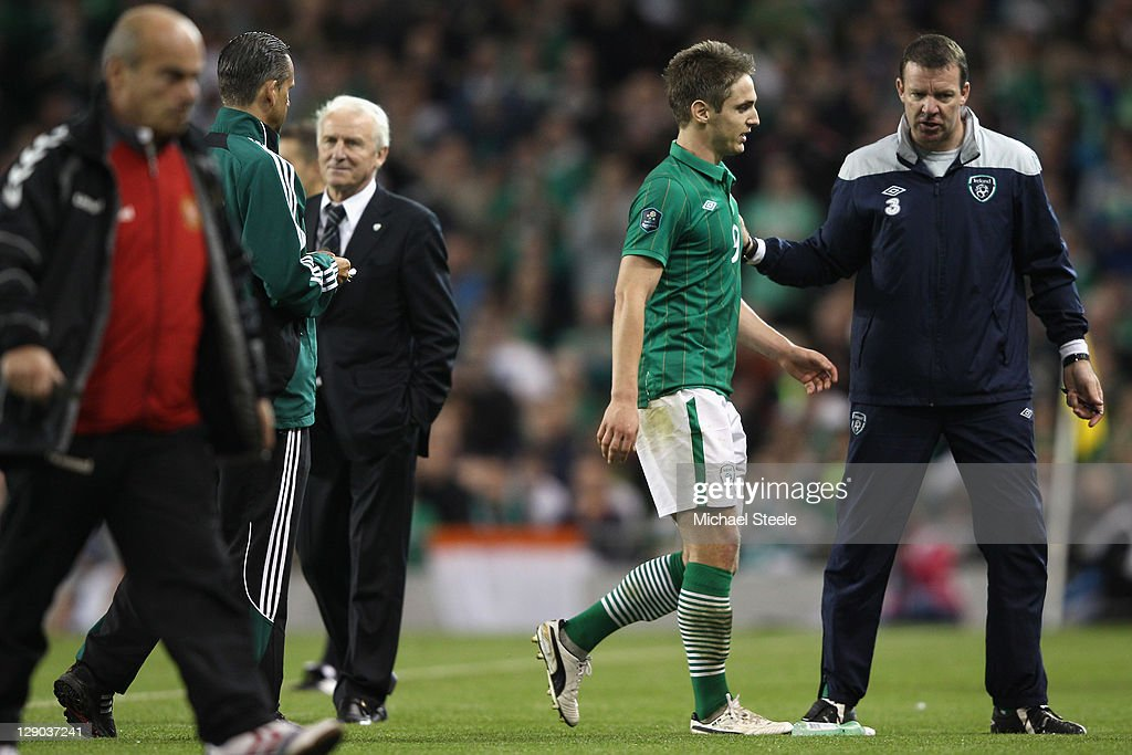 <a gi-track='captionPersonalityLinkClicked' href=/galleries/search?phrase=Kevin+Doyle+-+Soccer+Player&family=editorial&specificpeople=661496 ng-click='$event.stopPropagation()'>Kevin Doyle</a> (2R)of Republic of Ireland walks off the pitch after being sent off aided by Alan Kelly (R) the Ireland goalkeepoing coach as <a gi-track='captionPersonalityLinkClicked' href=/galleries/search?phrase=Giovanni+Trapattoni&family=editorial&specificpeople=209002 ng-click='$event.stopPropagation()'>Giovanni Trapattoni</a> (3L) coach of Ireland looks on during the EURO 2012 Group B qualifying match between the Republic of Ireland and Armenia at the Aviva Stadium on October 11, 2011 in Dublin, Ireland.