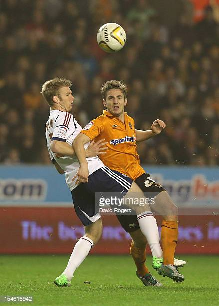 Kevin Doyle of Wolves is challenged by Tim Ream during the npower Championship match between Wolverhampton Wanderers and Bolton Wanderers at Molineux...