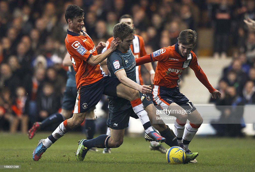 <a gi-track='captionPersonalityLinkClicked' href=/galleries/search?phrase=Kevin+Doyle+-+Soccer+Player&family=editorial&specificpeople=661496 ng-click='$event.stopPropagation()'>Kevin Doyle</a> of Wolves is tackled by Jonathan Smith (L) and JJ O'Donnell of Luton during the FA Cup with Budweiser Third Round match between Luton Town and Wolverhampton Wanderers at Kenilworth Road on January 5, 2013 in Luton, England.