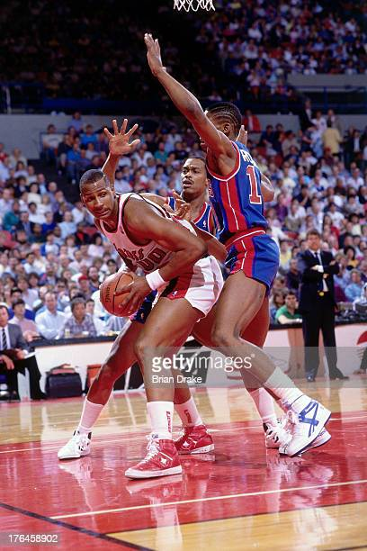 Kevin Duckworth of the Portland Trail Blazers posts up against Dennis Rodman of the Detroit Pistons during a game played circa 1987 at the Veterans...