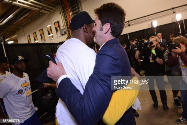 Kevin Durant and Bob Meyers of the Golden State Warriors hug after winning Game Four of the Western Conference Finals against the San Antonio Spurs...