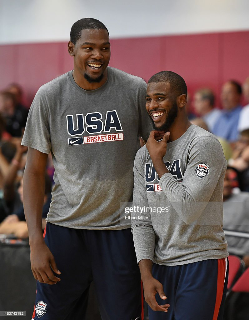 Kevin Durant and Chris Paul of the 2015 USA Basketball Men's National Team laugh during a practice session at the Mendenhall Center on August 12 2015...