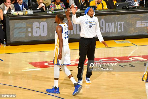 Kevin Durant and David West of the Golden State Warriors high five each other during the game against the Cleveland Cavaliersin Game Five of the 2017...