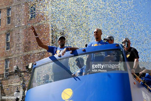 Kevin Durant and David West of the Golden State Warriors wave to the crowd during the Victory Parade and Rally on June 15 2017 in Oakland California...