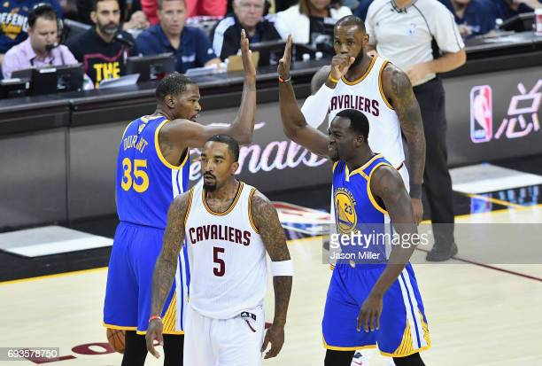 Kevin Durant and Draymond Green of the Golden State Warriors celebrate after a play in the first quarter against the Cleveland Cavaliers in Game 3 of...