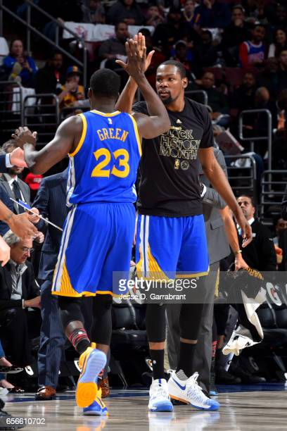 Kevin Durant and Draymond Green of the Golden State Warriors high five each other during the game against the Philadelphia 76ers at Wells Fargo...