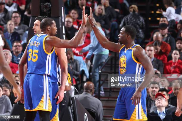 Kevin Durant and Draymond Green of the Golden State Warriors high five during the game against the Portland Trail Blazers during Game Four of the...