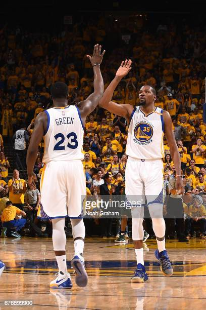 Kevin Durant and Draymond Green of the Golden State Warriors high five each other during the game against the Utah Jazz during Game One of the...