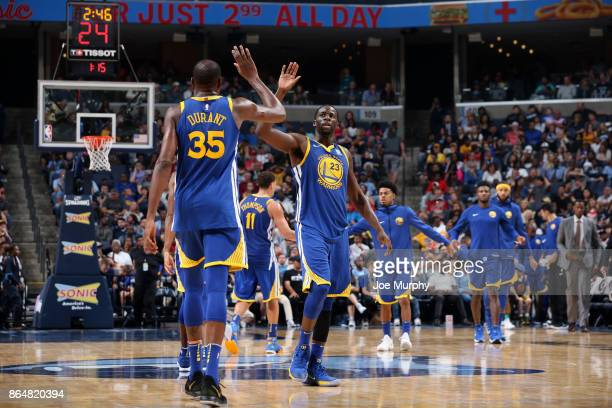 Kevin Durant and Draymond Green of the Golden State Warriors high five during the game against the Memphis Grizzlies on October 21 2017 at FedExForum...