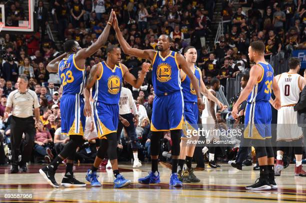 Kevin Durant and Draymond Green of the Golden State Warriors highfive in Game Three of the 2017 NBA Finals on June 7 2017 at Quicken Loans Arena in...