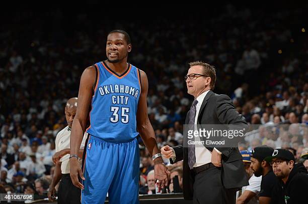 Kevin Durant and Head coach Scott Brooks of the Oklahoma City Thunder talk during the game against the Golden State Warriors on January 5 2015 at...