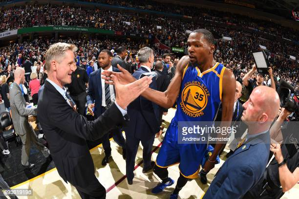 Kevin Durant and head coach Steve Kerr of the Golden State Warriors celebrate after Game Three of the 2017 NBA Finals on June 7 2017 at Quicken Loans...