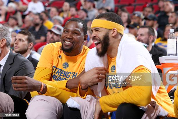 Kevin Durant and JaVale McGee of the Golden State Warriors smiles during the game against the Portland Trail Blazers during Game Four of the Western...