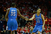 Kevin Durant and Kevin Martin of the Oklahoma City Thunder celebrate a play during the game against the Houston Rockets in Game Six of the Western...